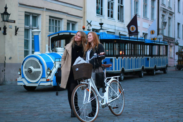 Women in front of the City Train in the Old Town of Tallinn, Estonia.