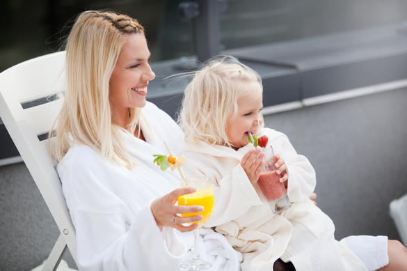 Woman and a child having colourful cocktails at the Kalev Spa water park in Tallinn, Estonia.