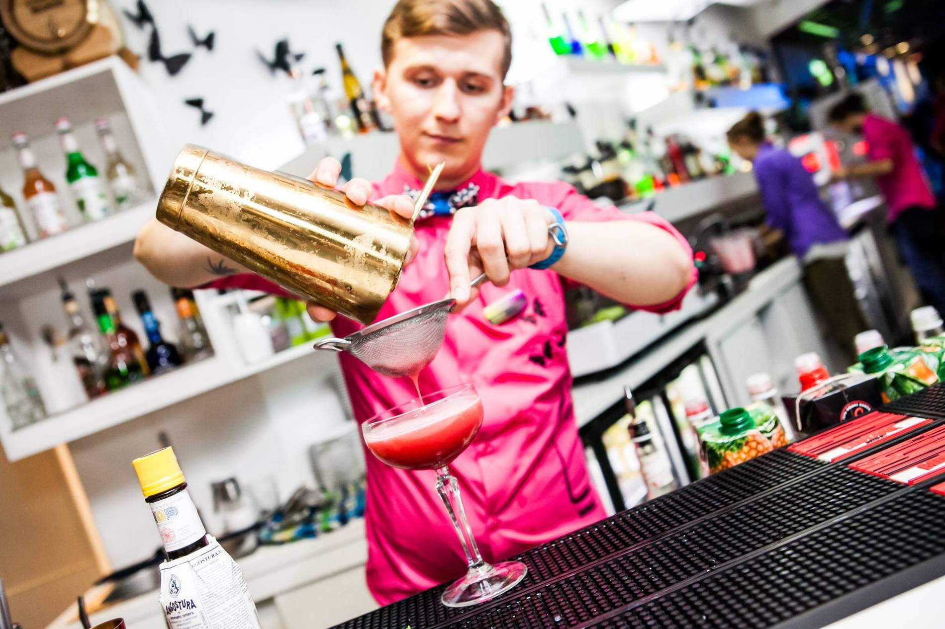 Bartender pouring a cocktail at the Butterfl Lounge in Tallinn, Estonia