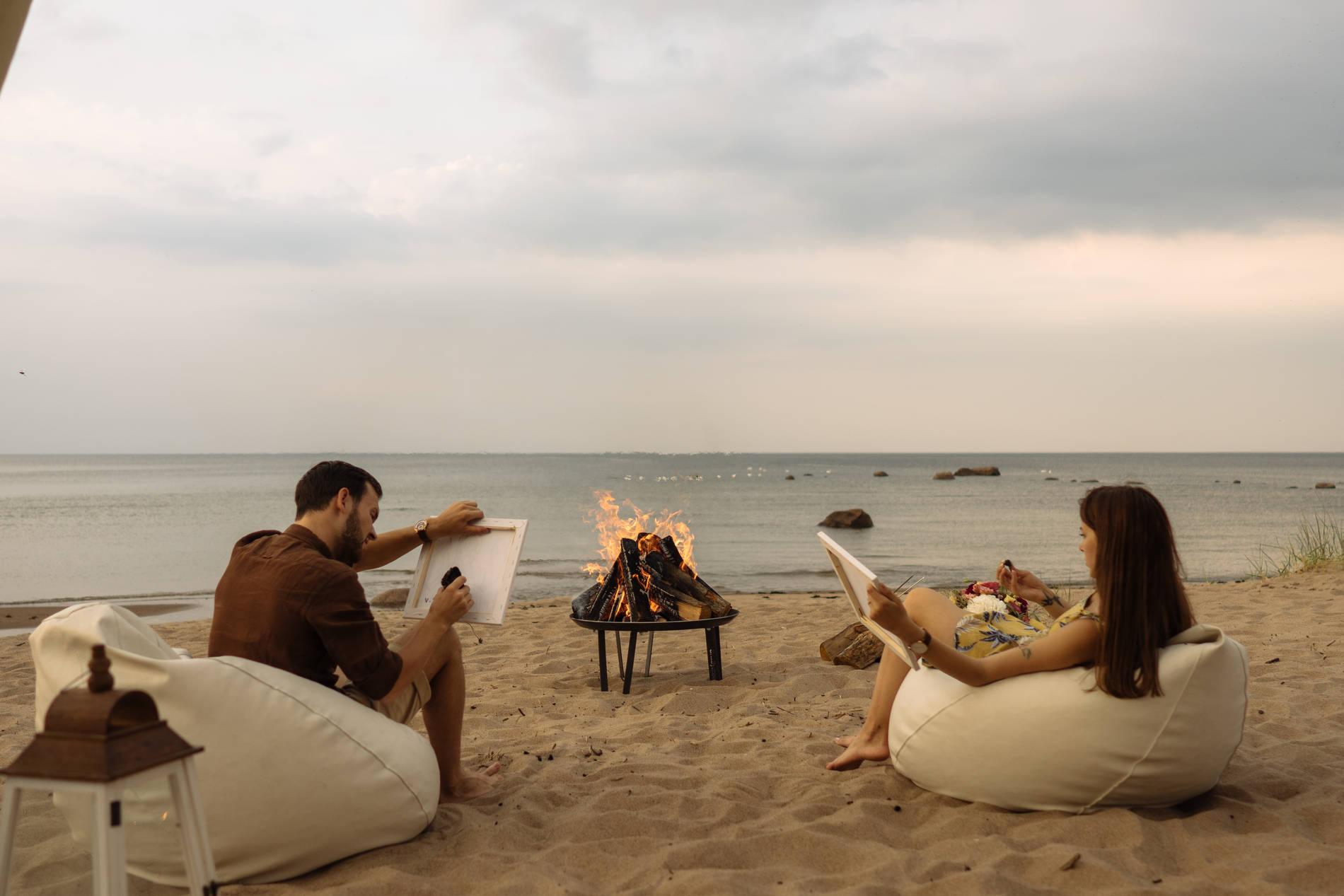 A couple on a beach in Tallinn, Estonia