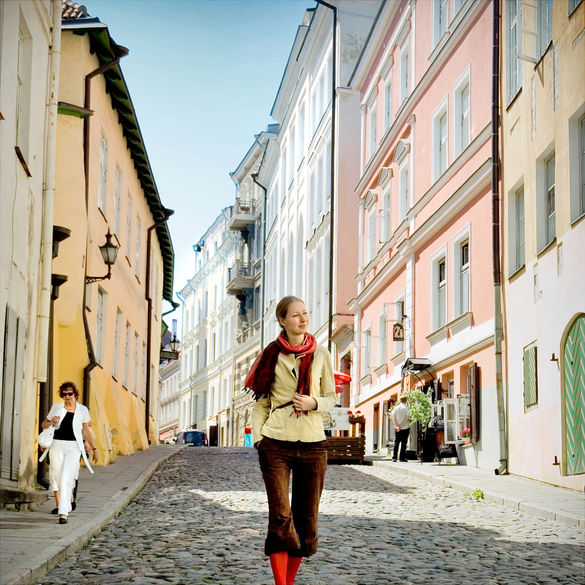 A woman waliking at the Old Town of Tallinn in Estonia.