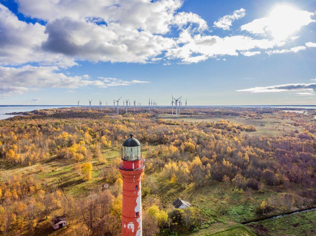 View to the lighthouse, forest and the wind turbines in Estonia