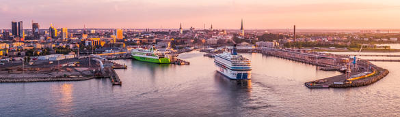 Aerial view to Tallinn and Tallinn Old Town from the sea, ships approaching the port.
