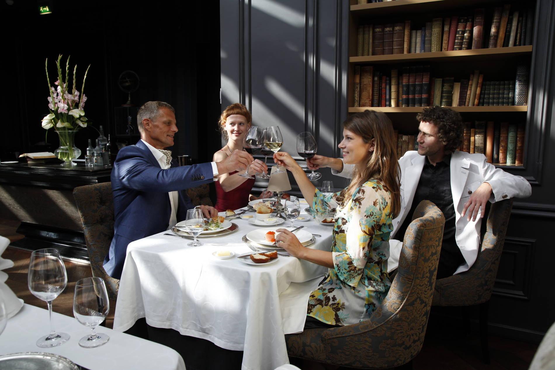 People enjoying dinner at a restaurant in Tallinn, Estonia