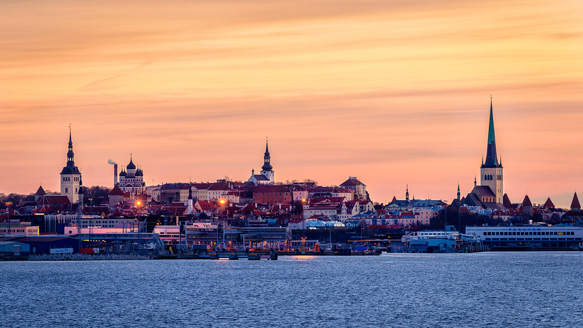 View of the Old Town silhouette during sunset in Tallinn, Estonia.