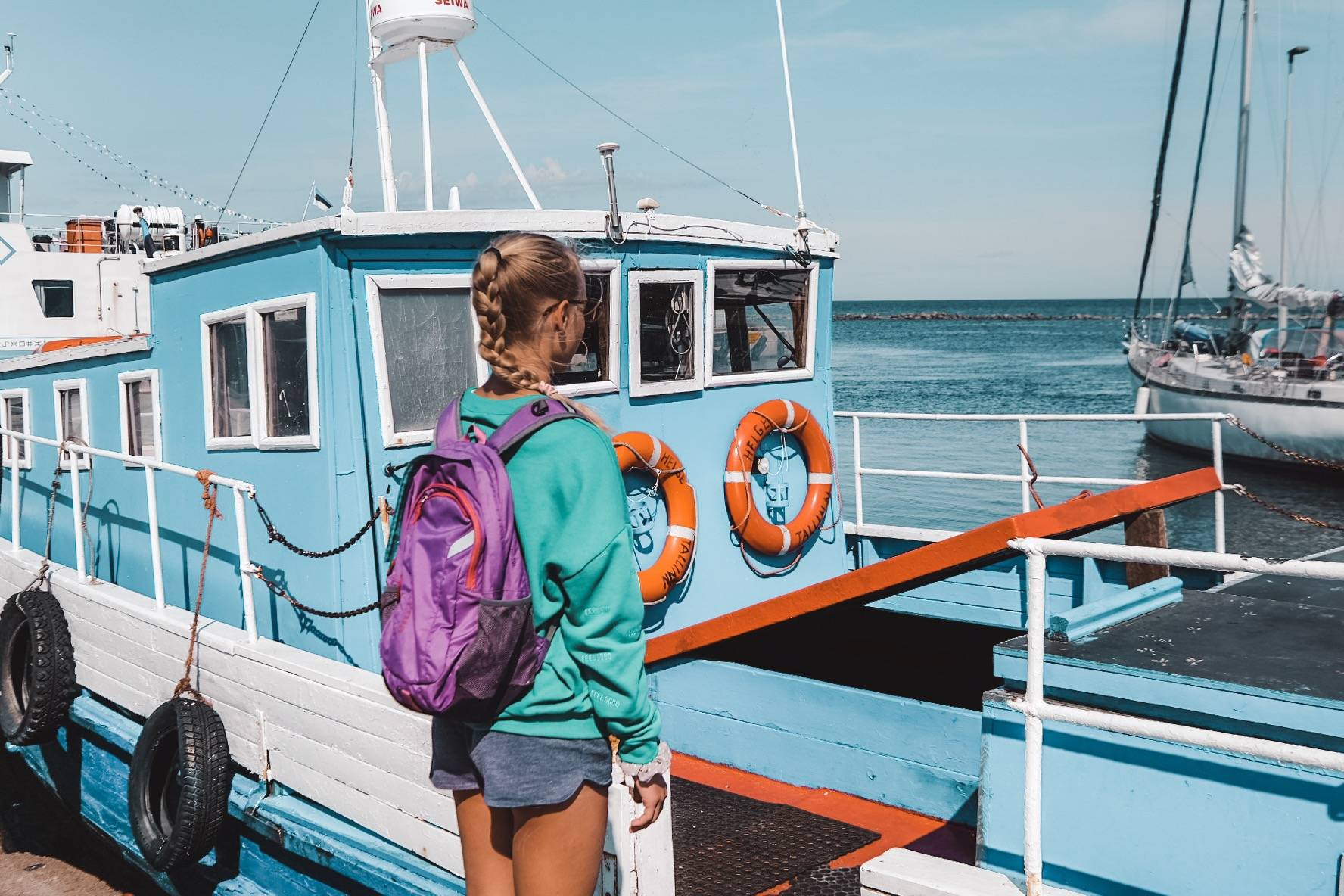 Girl in the harbour of Prangli, Estonia