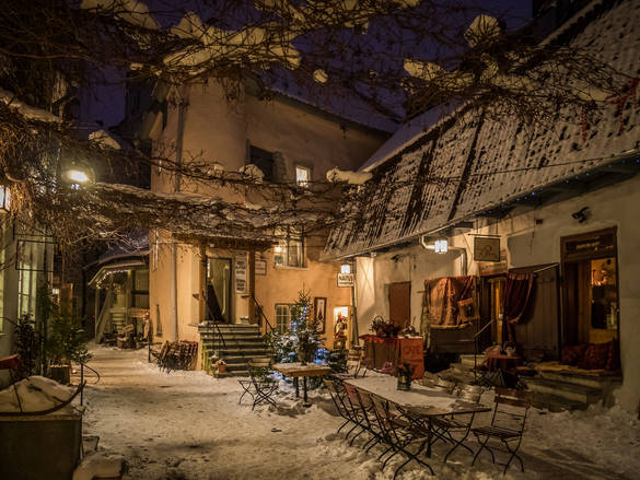Lovely external view of the cafes at the Masters' Courtyard in Tallinn, Estonia in winter.