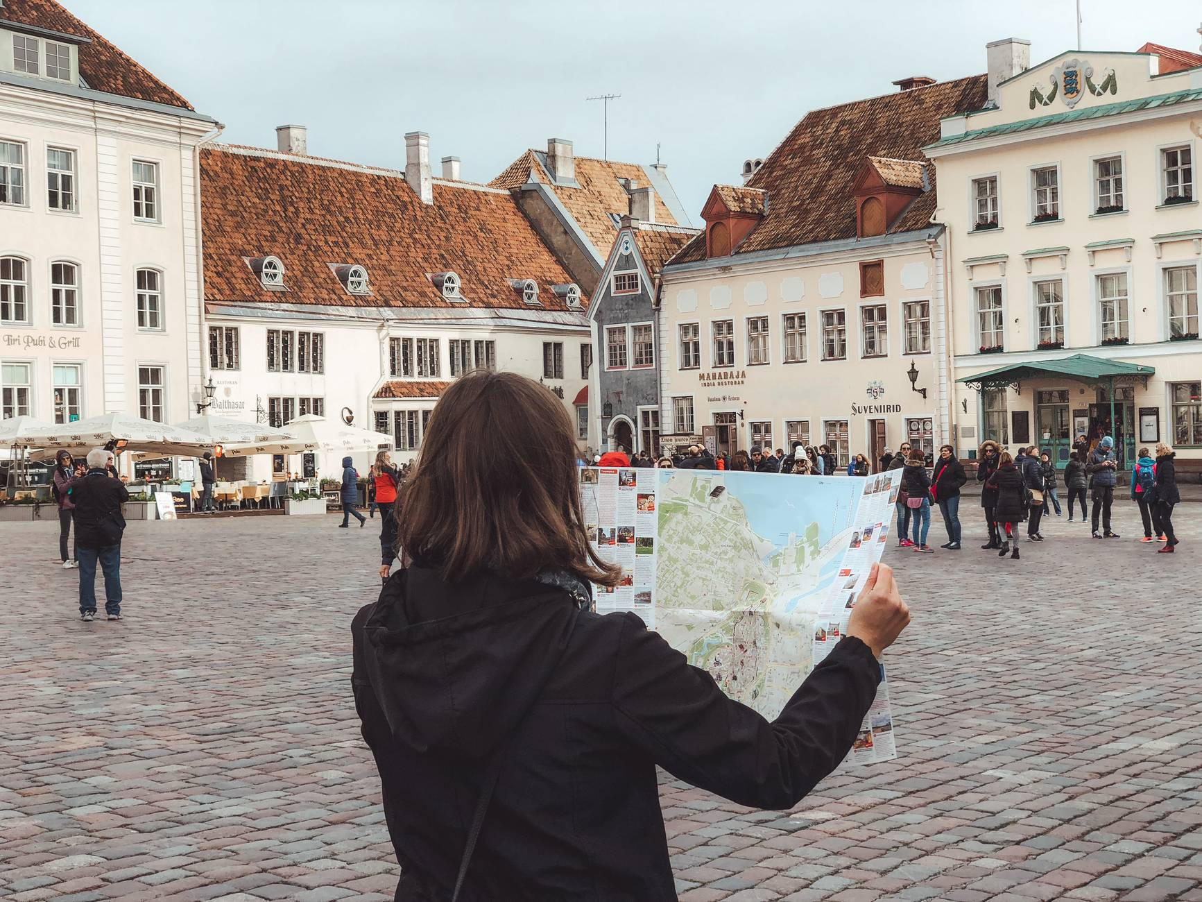 Looking at a map on the Town Hall Square of Tallinn, Estonia
