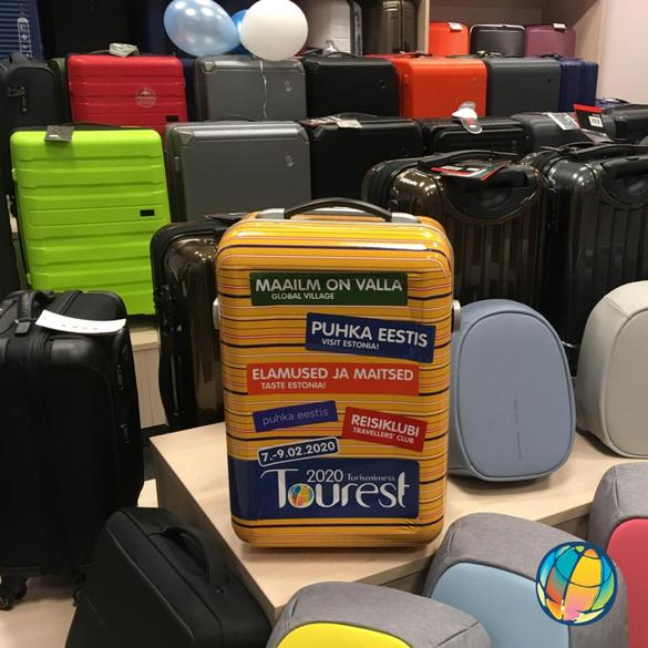 Photo of a yellow suitcase logos of Tourest, the largest travel fair in the Estonia