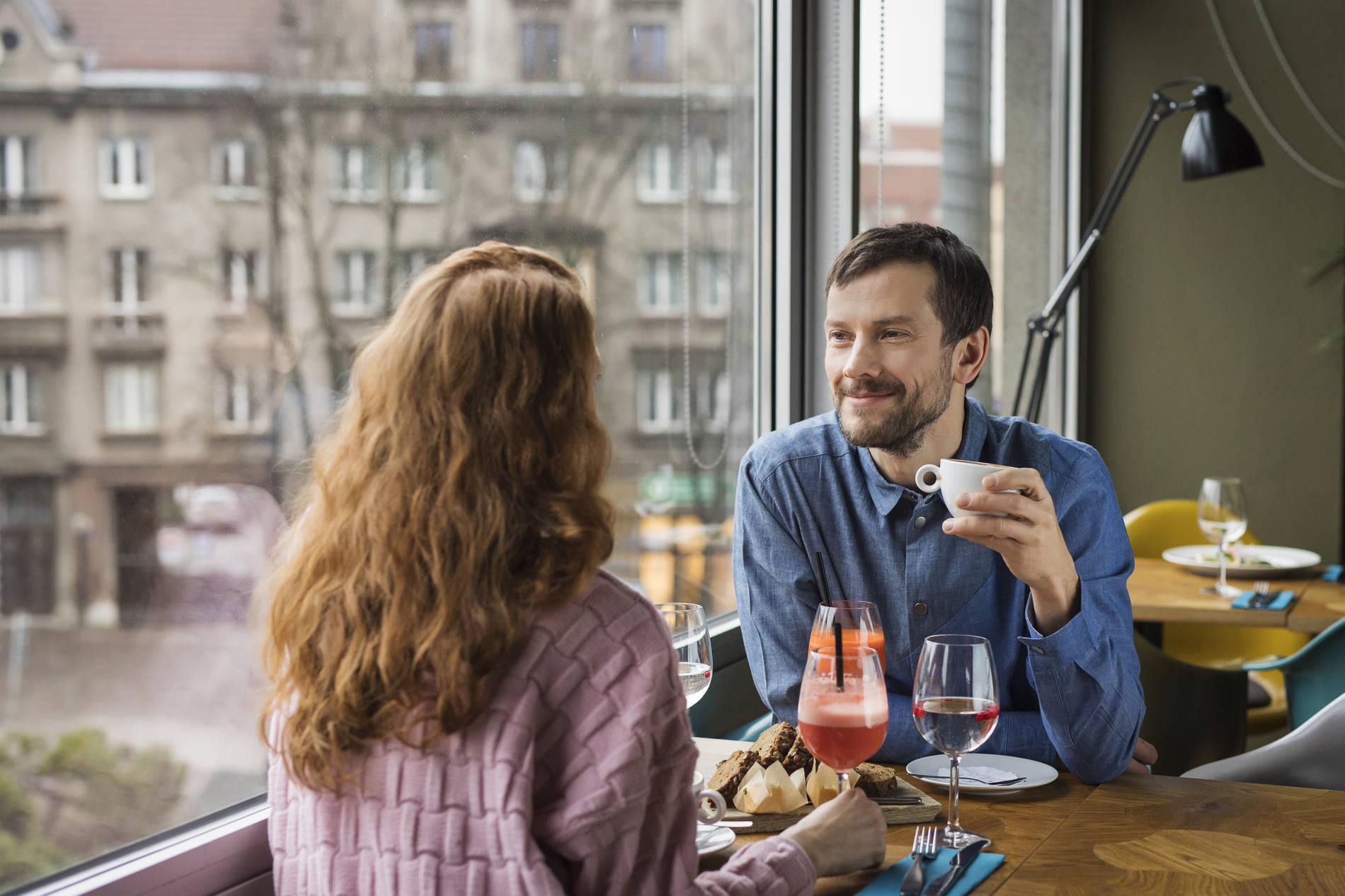 A woman and a man in a restaurant in Tallinn, Estonia