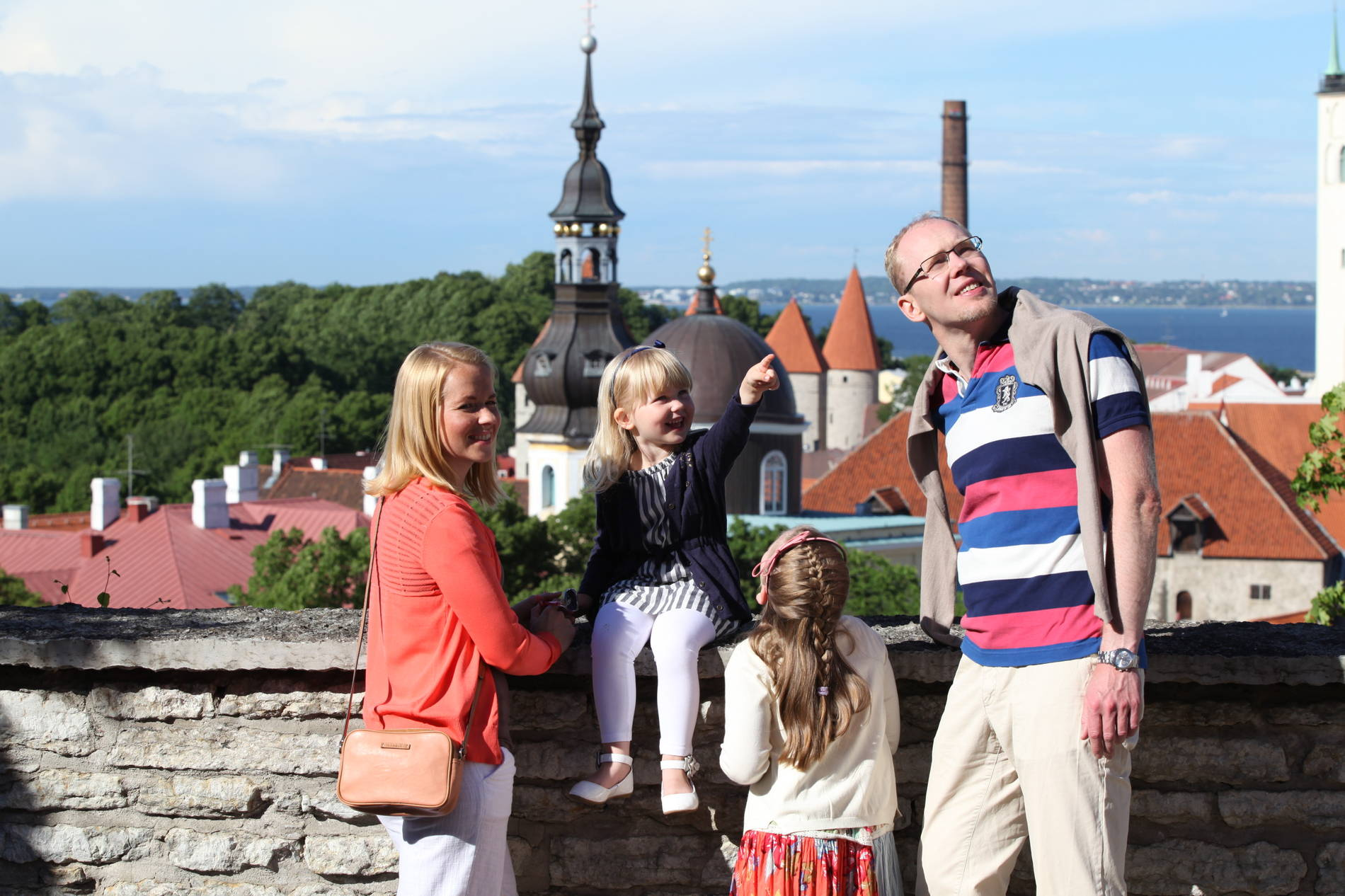 Family at the viewing platform in the Old Town of Tallinn, Estonia.