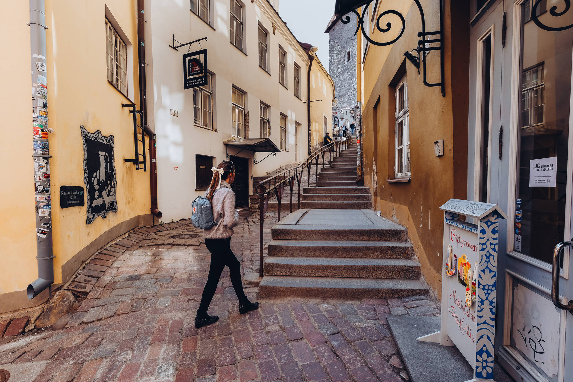 A woman on a romantic street in the medieval Old Town of Tallinn, Estonia