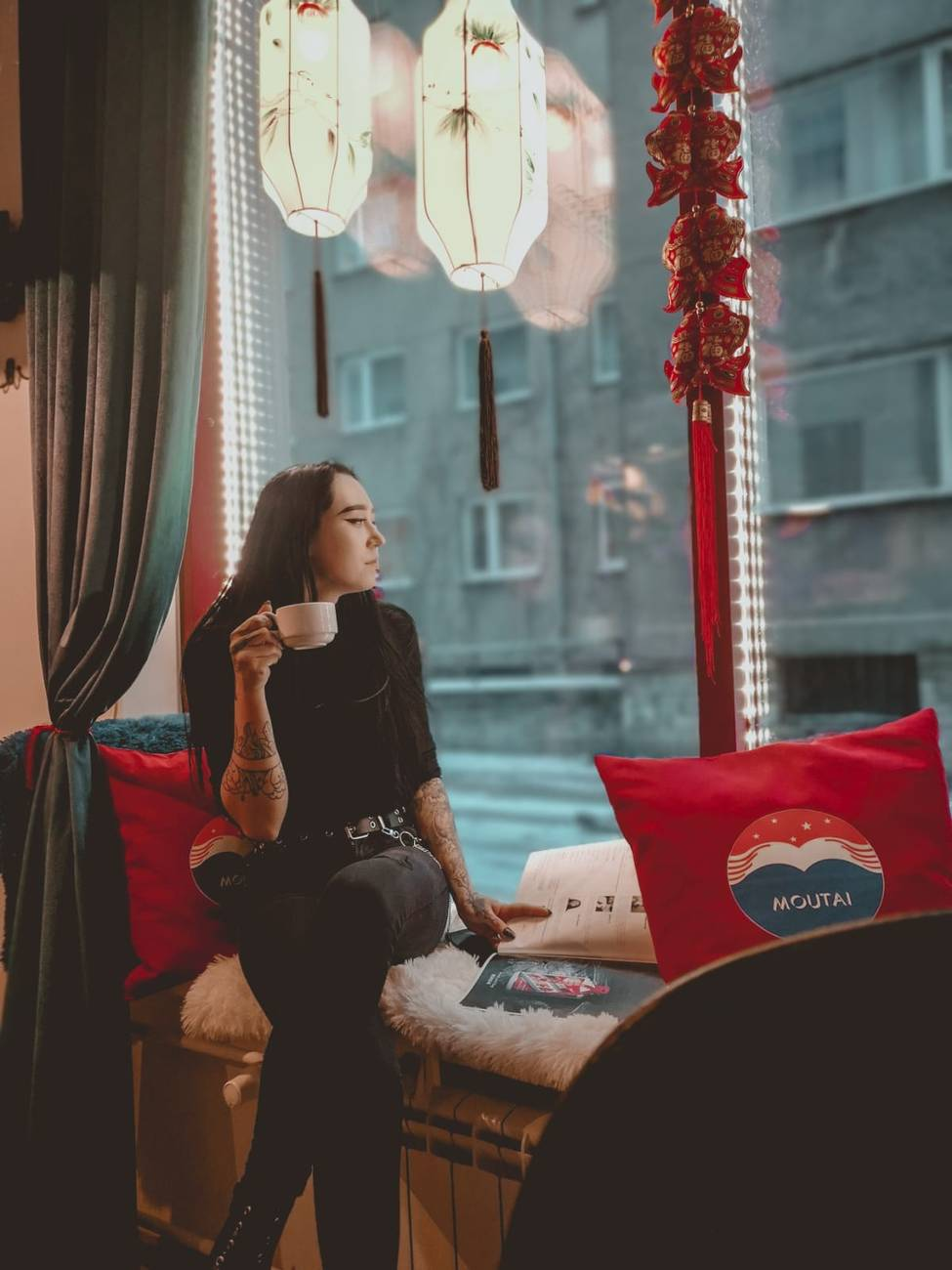 Girl enjoying a tea at the Moutai Bar in the Old Town of Tallinn, Estonia