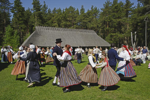 Folk dancers performing in front of an old tavern in the Open Air museum in the Rocca al Mare area Tallinn, Estonia.