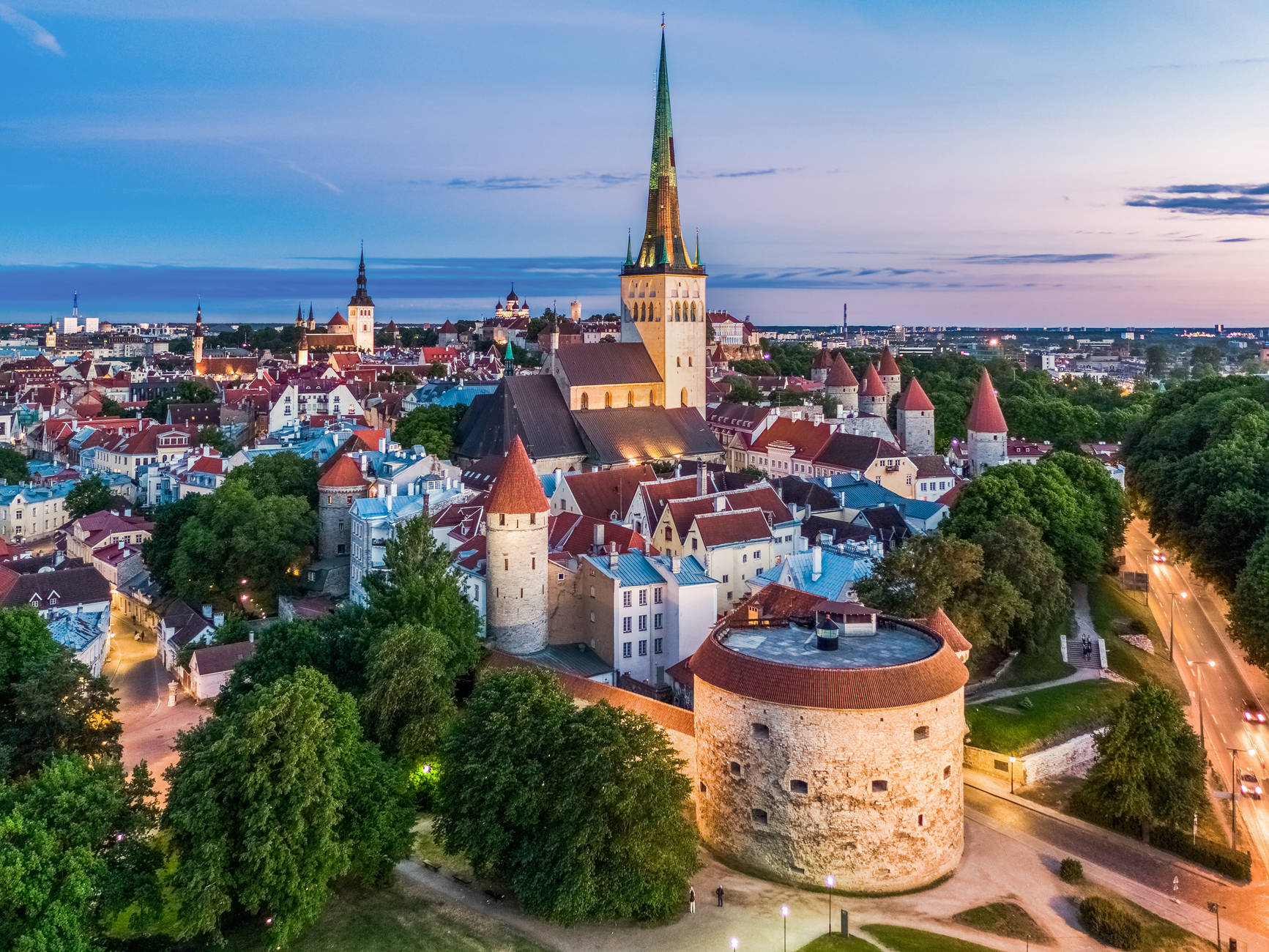A nighttime view od the Old Town and the medieval Fat Margaret cannon tower in Tallinn, Estonia