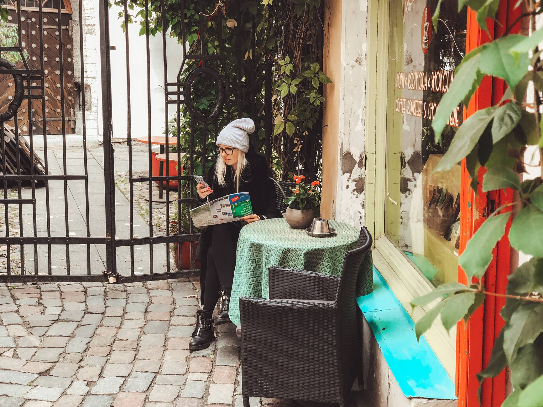 Woman at  the Old Town of Tallinn, Estonia, looking at a map of the city.