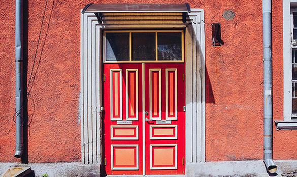 A red door in Kalamaja, a bohemian neighbourhood in Tallinn, Estonia
