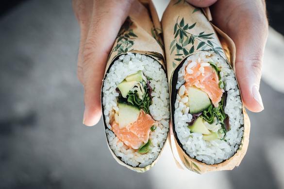Sushi burrito that was made in the Yui Sushi Burrito restaurant in the City Center of Tallinn, Estonia.